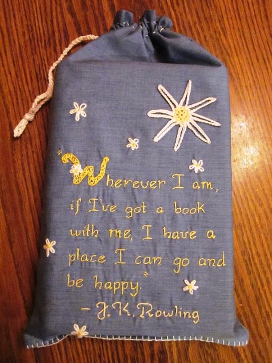An embroidered book bag my wife made - designed to keep your books from getting banged up inside your backpack. This one is for larger hardbacks (or several smaller books). She is planning on making some smaller one with another quote later on.